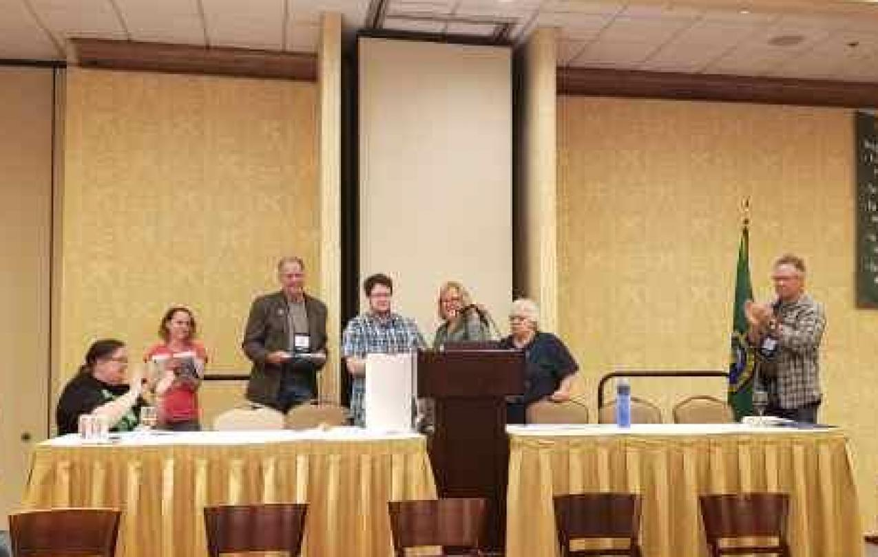 Jordan Harrington speaks at a podium after winning the Rising Star Award.