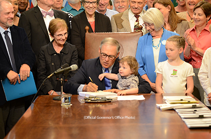 Gov. Jay Inslee signs a bill Thursday to create the new Washington State Department of Children, Youth and Families. (Official Governor's Office Photo)