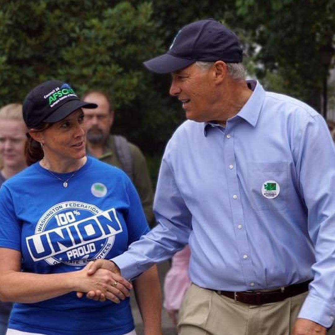 WFSE Executive Director Leanne Kunze and WFSE members walk with Governor Jay Inslee.